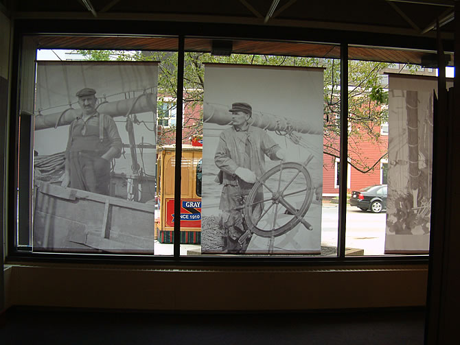 Photo panels in museum windows